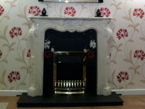 Photo - Decorative fireplace, wall-papering and laminate flooring for a Penwortham property
