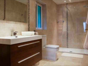 Photo - Luxurious fitted bathroom with walk-in shower installed as an en-suite to a hotel bedroom